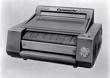 The company's first copier, Minolta Copymaster, (a wet-process diazo copier) is completed